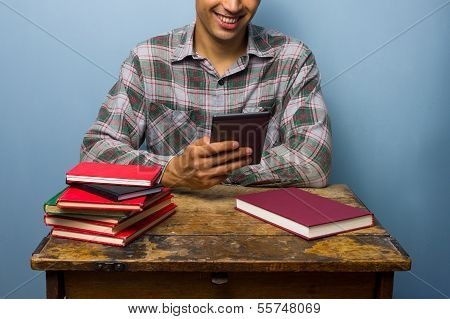 Young Man Prefers His E-reader To Books
