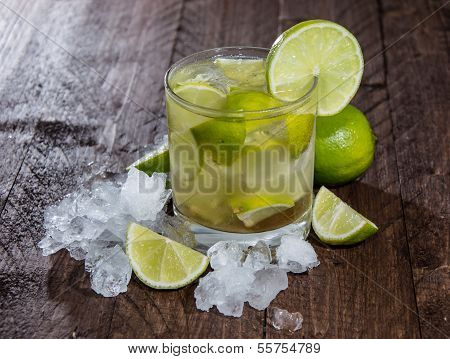 Caipirinha With Crushed Ice On Wood