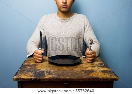 Young Man Waiting For His Dinner