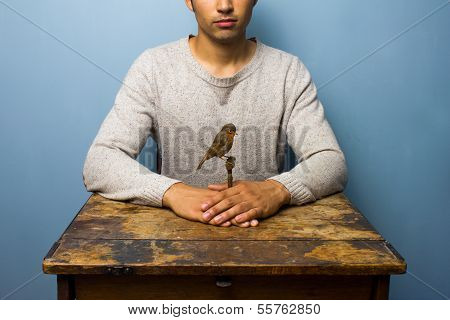 Man At Desk Holding Taxidermy Robin