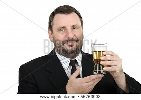 Bearded Man In Black Suit Holds Lager Glass