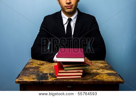 Businessman With Stack Of Books