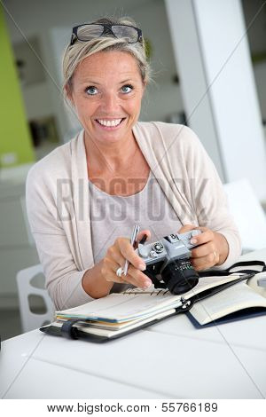 Beautiful mature woman reporter working on project