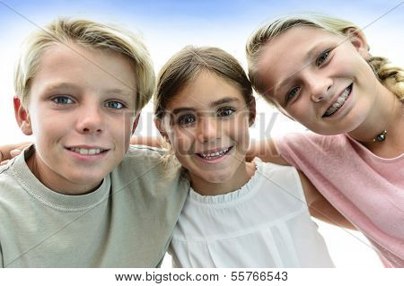Portrait of kids with arms around each other