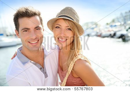 Portrait of cheerful couple of tourists