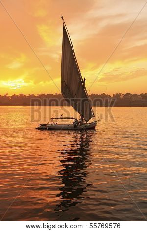 Felucca Boat Sailing On The Nile River At Sunset, Luxor
