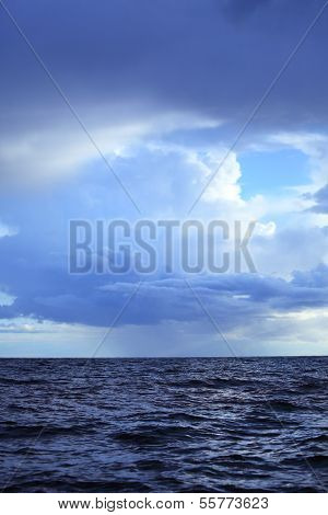 Cloudy Dark Sky Above A Surface Of The Sea