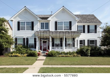 White Suburban Home With Front Porch