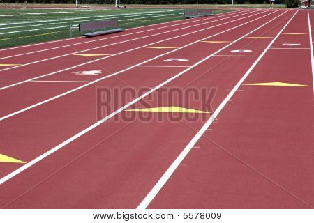 Man Walking On Numbered Stadium Track