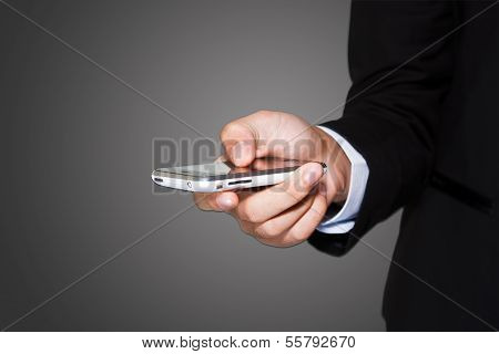 Close up of a man using mobile isolated with path