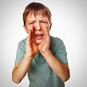 stock photo of shouting  - boy kids teenager calling cries shouts opened his mouth isolated background gray - JPG