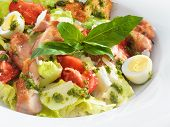 foto of romaine lettuce  - Tasty healthy Caesar salad with sweet basil and lettuce on a round plate - JPG