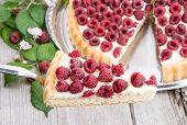 picture of tarts  - Cake lifter with Raspberry Tart on wooden background - JPG