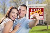 foto of arms race  - Mixed Race Excited Military Couple In Front of New Home with New House Keys and Sold Real Estate Sign Outside - JPG