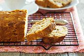 pic of pound cake  - Cake with pieces of apples sliced on a cooling rack - JPG