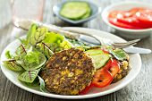 foto of chickpea  - Vegan chickpeas burgers with salad and vegetables - JPG