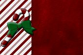 stock photo of candy cane border  - Candy Cane and Red Plush Fabric Christmas Background with center copy - JPG