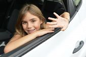 stock photo of waving hands  - Little girl waving hand by car window - JPG