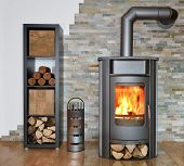 stock photo of briquette  - wood fired stove with fire - JPG