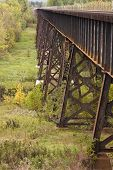 stock photo of trestle bridge  - A steel railroad bridge spanning a ravine - JPG