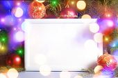 foto of boll  - Colorful abstract background with christmas lights and white frame.