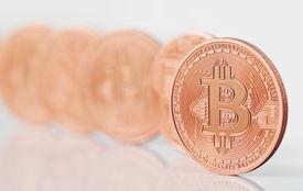 stock photo of bit coin  - Golden bit coin BTC  (new virtual money ) ** Note: Shallow depth of field - JPG