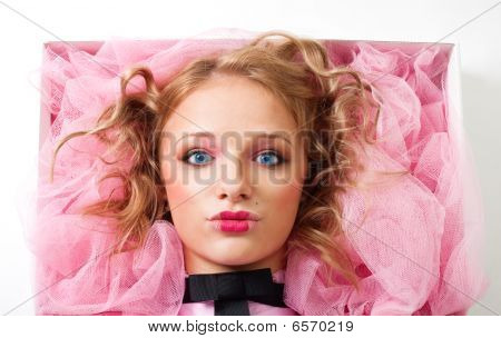 Face Of A Woman Doll Lay In Box