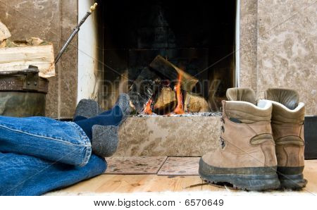 Hiker Resting By The Fireplace