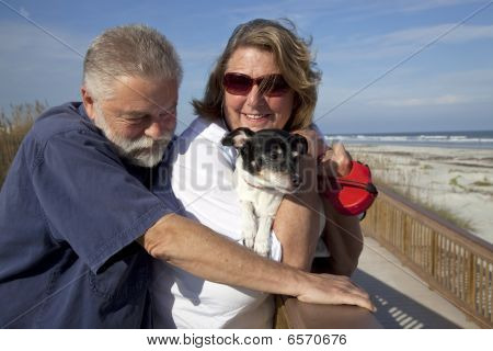 Older couple with dog at beach