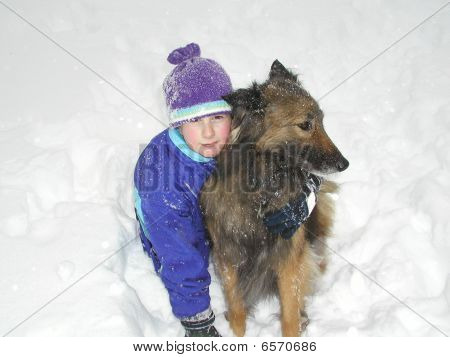 Young girl and her dog in the snow