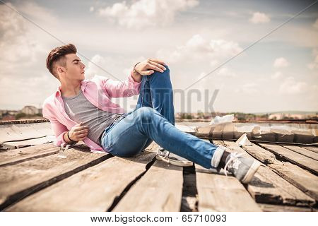 fashion model posing while lying down and looks away