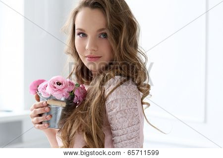 Cute, young girl with flowers