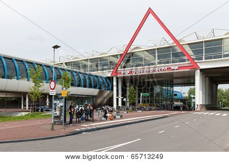 Travellers Are Waiting At Bus Stop Near A Dutch Railway Station