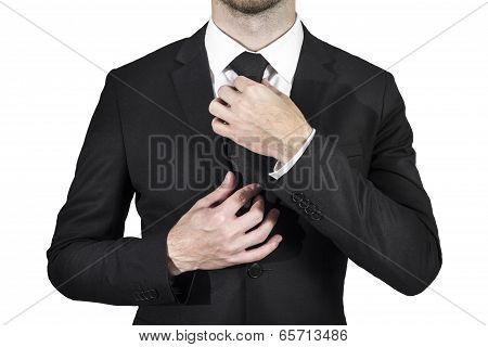 businessman correcting necktie