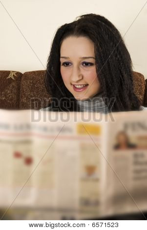 Young Lady Read The Newspaper
