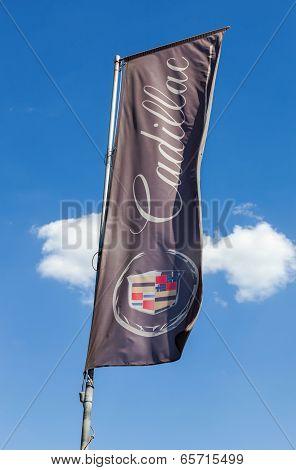 Samara, Russia - May 24, 2014: The Flag Of Cadillac Over Blue Sky. Cadillac Motor Car Division Is A
