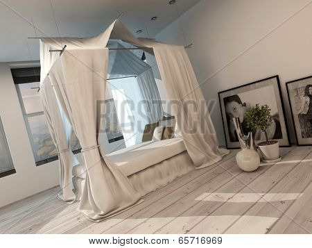 Stylish minimalist modern bedroom interior with a four poster bed, white painted parquet floor and light, bright view windows along one wall
