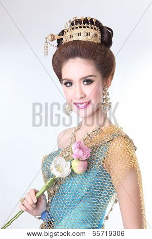 elegant fashion asian woman posing with creative chignon hair-style and wearing blue thai dress