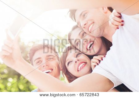 Friends taking photo of themselves