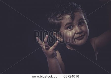 little boy with slicked-back hair, funny and expressive