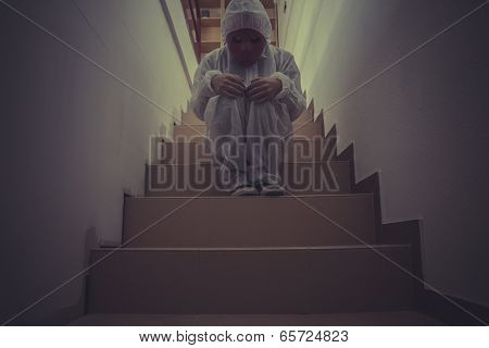 Scary nightmare man with red mask in empty room