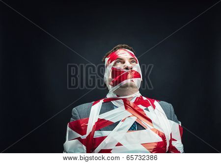 Man with stripped duct tape over body