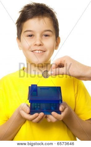 Boy With Coin Bank