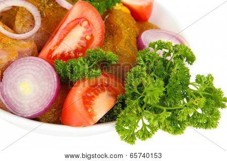 Raw turkey meat with vegetables and spices close up