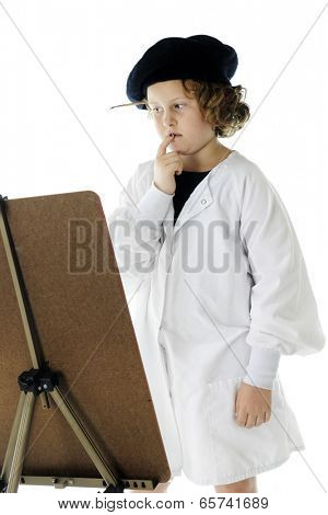An elementary-aged artist in a French beret and white smock, looking at her work but not sure about what more is needed.  On a white background.