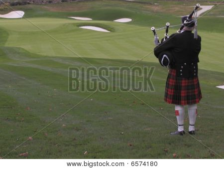 Bagpiper on golf course