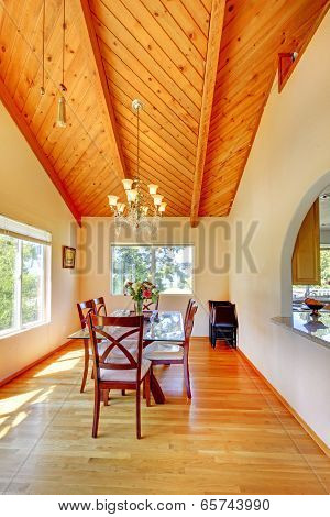Beautiful Dining Area With High Vaulted Ceiling