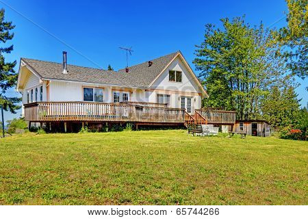 Old Farm House With Walkout Deck. Backyard View
