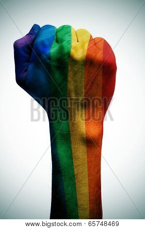 raised fist patterned with the rainbow flag, symbolizing the fight for gay rights