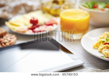 Fresh Continental Breakfast. Tablet, Black Screen, Selective Focus.